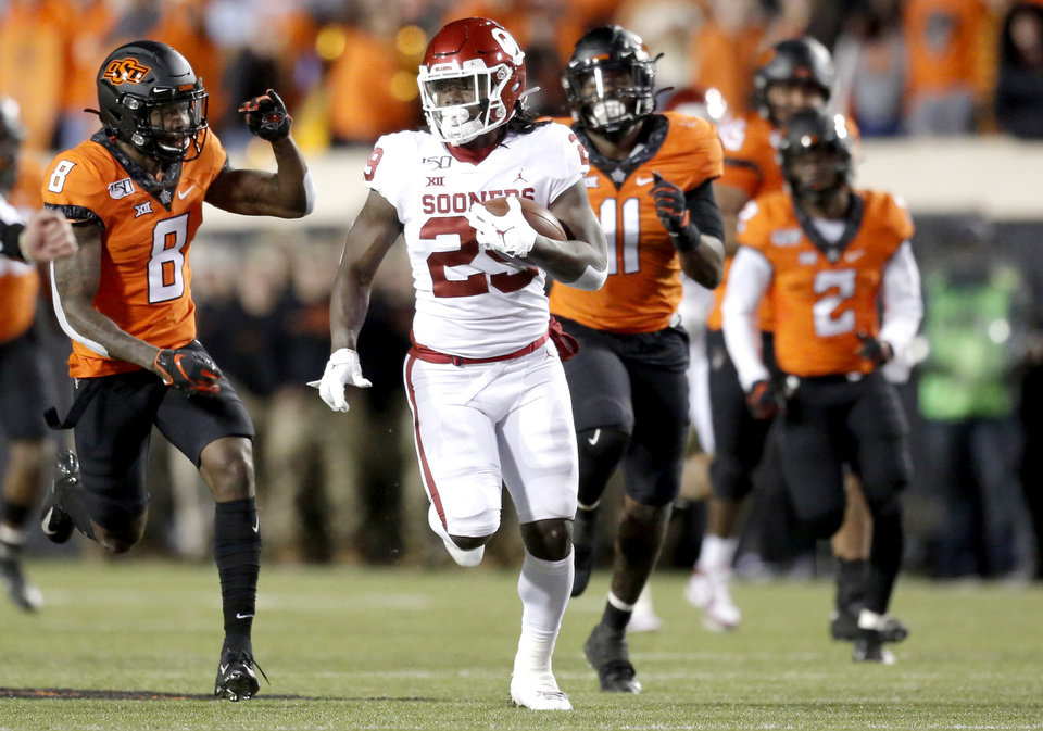 Photo - Oklahoma's Rhamondre Stevenson (29) rushes in the fourth quarter during the Bedlam college football game between the Oklahoma State Cowboys (OSU) and Oklahoma Sooners (OU) at Boone Pickens Stadium in Stillwater, Okla., Saturday, Nov. 30, 2019. OU won  34-16. [Sarah Phipps/The Oklahoman]