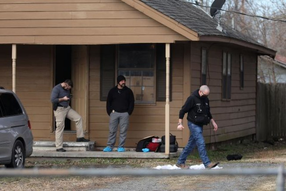 Photo -  Investigators work at the scene of a suspected mass homicide where at least 5 children were slain Tuesday, Feb. 2, 2021 in Muskogee, Okla. [Photo by Mike Simons, Tulsa World]