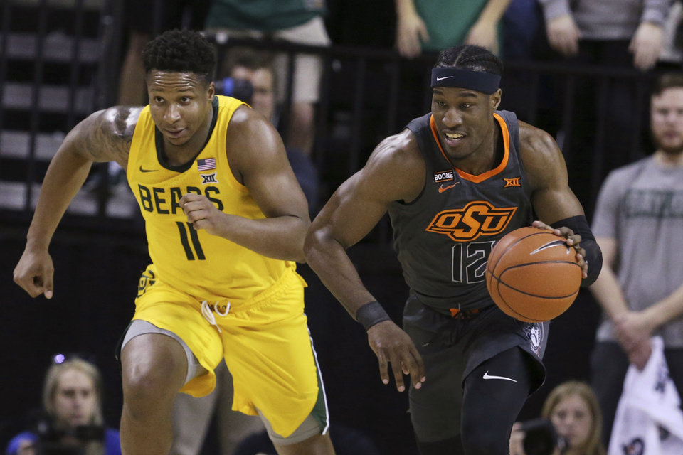 Photo - Oklahoma State forward Cameron McGriff, right, heads upcourt past Baylor guard Mark Vital, left, after a turnover during the first half of an NCAA college basketball game Saturday, Feb. 8, 2020, in Waco, Texas. (AP Photo/Rod Aydelotte)