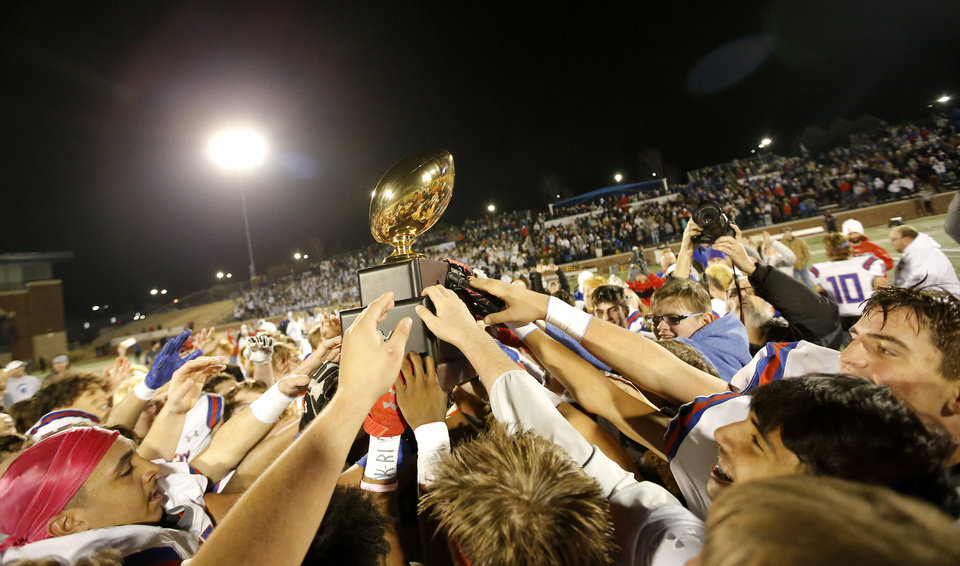 Photo - Bixby celebrates the 6A II state football championship over Stillwater at Wantland Stadium in Edmond, Okla., Friday, Dec. 6, 2019. [Sarah Phipps/The Oklahoman]