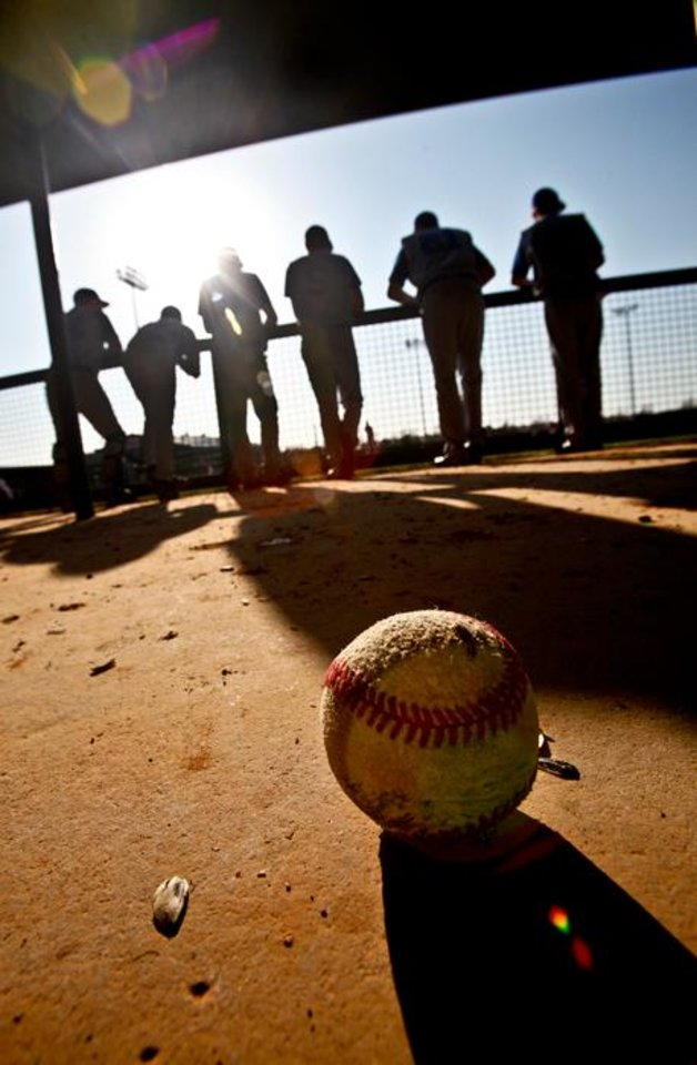 Photo -  Deer Creek High School players watch the game from the dugout as the Antlers play Carl Albert during a high school baseball game at Carl Albert High School on Monday, March 29, 2010, in Midwest City, Okla.   Photo by Chris Landsberger, The Oklahoman  ORG XMIT: KOD