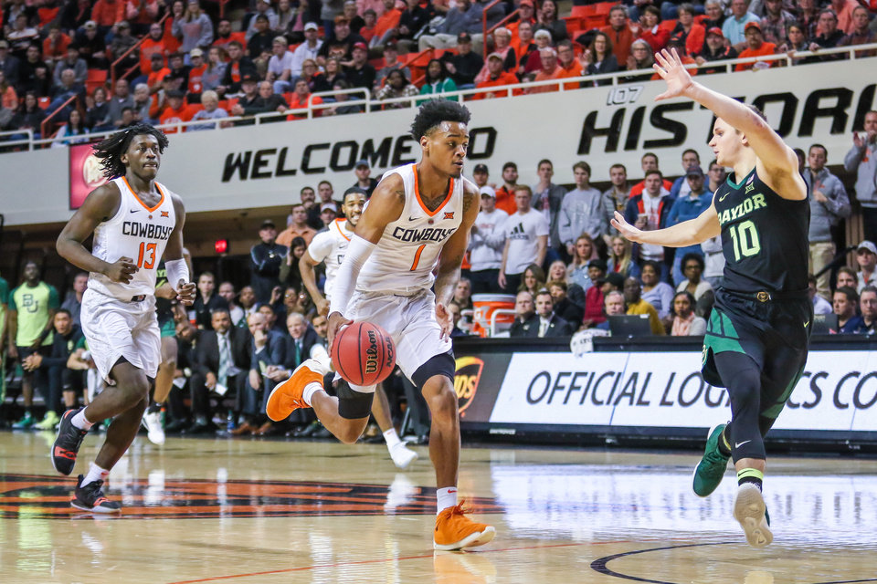 Photo - No. 1 Curtis Jones drives into the paint against Baylor guard No. 10 Makai Mason during Oklahoma State's basketball game vs. Baylor on Jan. 14, 2019, in Stillwater, Oklahoma at Gallagher-Iba Arena. (DEVIN LAWRENCE WILBER/Tulsa World)