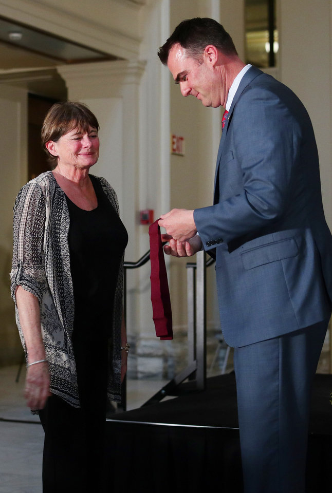 Photo - Pamela Catt receives a Arts in Education Award from Governor Kevin Stitt at the Governor's Arts Awards at the Capitol, Tuesday, April 16, 2019. Photo by Doug Hoke/The Oklahoman