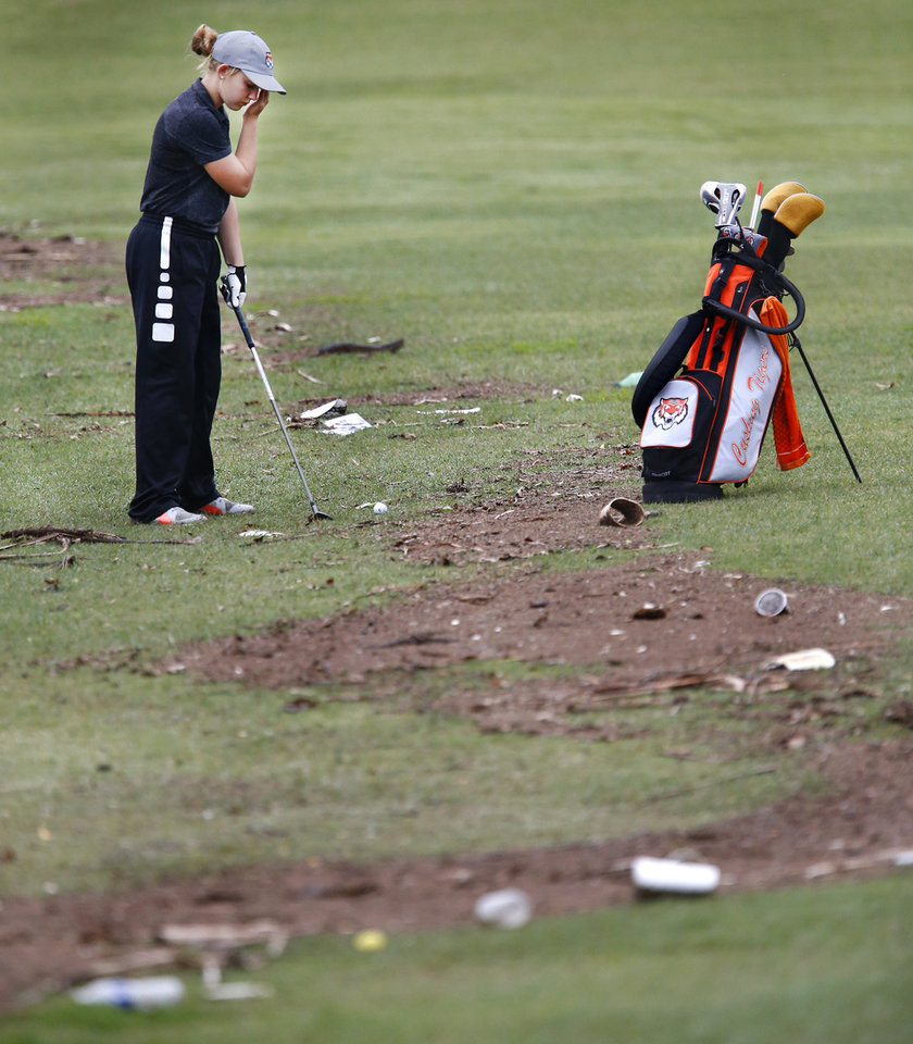 Photo - Cushing golfer Kaybre Wright gets ready to hit her ball on the #7 fairway which is littered by debris caused by heavy rains and the flooding of a creek that borders the course on Tuesday. Class 4A girls golf state tournament at Hefner South golf course on Wednesday, May 2, 2019.  [Jim Beckel/The Oklahoman]