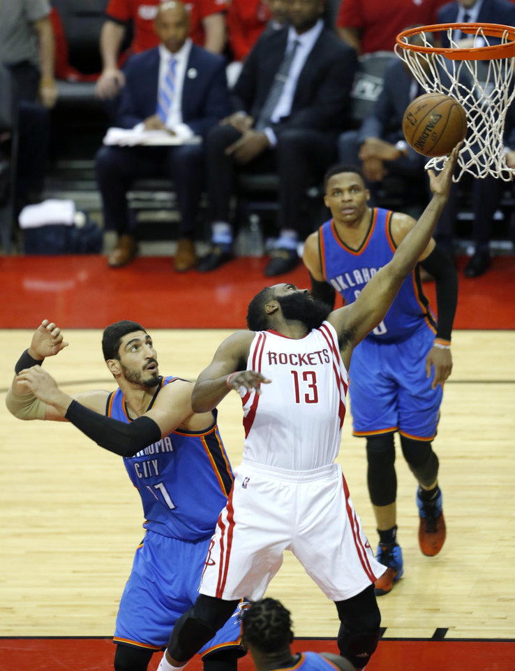 Photo - Houston's James Harden (13) shoots a a a lay up in front of Oklahoma City's Enes Kanter (11) during Game 2 in the first round of the NBA playoffs between the Oklahoma City Thunder and the Houston Rockets in Houston, Texas,  Wednesday, April 19, 2017.  Photo by Sarah Phipps, The Oklahoman