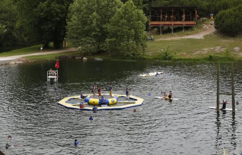 Photo -  Campers play in a lake at Falls Creek.