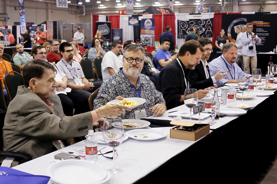 Photo -  Judges sample a contestant's dish at the Culinary Cook-off at the Oklahoma Restaurant Association Convention and Expo. [Photo by Jim Beckel, The Oklahoman]