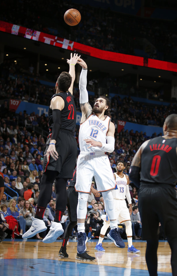 Photo - Oklahoma City's Steven Adams (12) shoots over Portland's Jusuf Nurkic (27) during the NBA basketball game between the Oklahoma City Thunder and the Portland Trail Blazers at Chesapeake Energy Arena in Oklahoma City, Tuesday, Jan. 22, 2019. Photo by Sarah Phipps, The Oklahoman