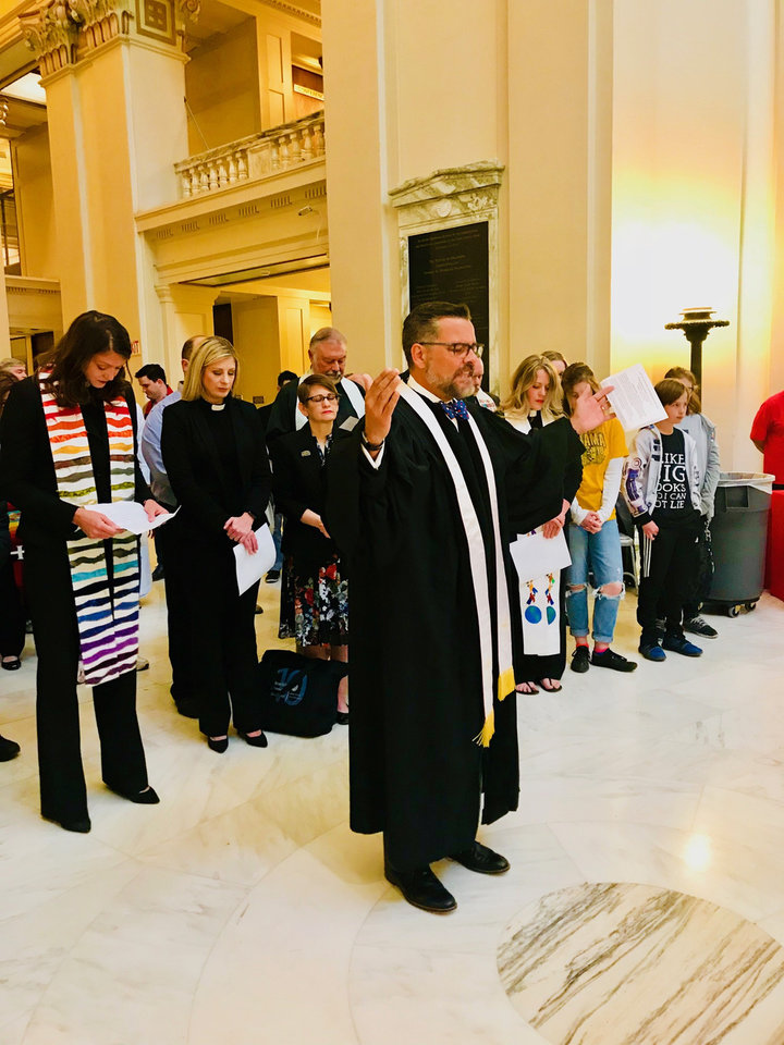 Photo - The Rev. Mitch Randall, executive director of EthicsDaily.com and former senior pastor of NorthHaven Church in Norman, prays for teachers and public education at a prayer event on Thursday at the State Capitol. [Photo by Carla Hinton, The Oklahoman]