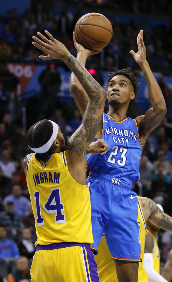 Photo - Oklahoma City's Terrance Ferguson (23) shoots as Los Angeles' Brandon Ingram (14) defends during an NBA basketball game between the Los Angeles Lakers and the Oklahoma City Thunder at Chesapeake Energy Arena in Oklahoma City, Thursday, Jan. 17, 2019. Photo by Nate Billings, The Oklahoman