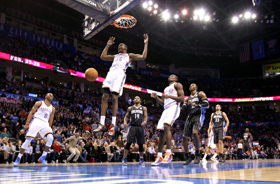 Photo - Kevin Durant (35) celebrates a basket  during the opening day NBA basketball game between the Oklahoma CIty Thunder and the Orlando Magic at Chesapeake Energy Arena in Oklahoma City, Sunday, Dec. 25, 2011. Photo by Sarah Phipps, The Oklahoman