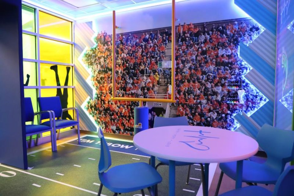 Photo - Timmy's Playroom includes a football themed area for play and socialization. [PHOTO PROVIDED]