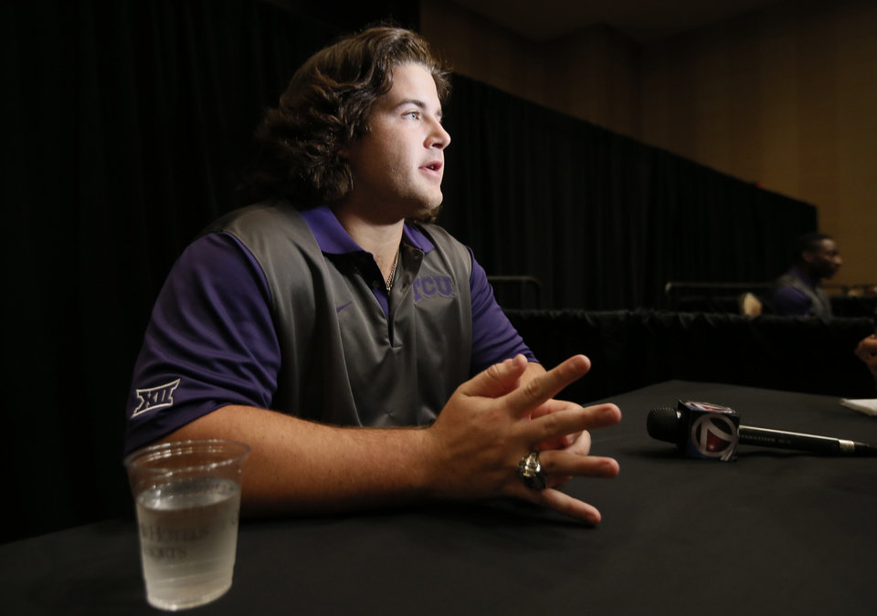 Photo - TCU offensive lineman Joey Hunt responds to questions during Big 12 Conference Football Media Days, Monday, July 20, 2015, in Dallas. (AP Photo/Tony Gutierrez)