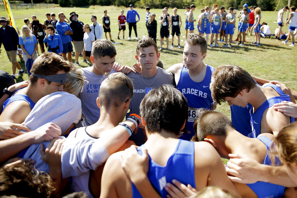 Photo - Newcastle runner Caleb Freeman, who was injured in a 2017 car crash, prays before a cross country race at Carl Albert in Midwest City, Okla., Tuesday, Oct. 8, 2019. This was Caleb Freeman's first cross country race since getting injured in a 2017 car wreck.[Bryan Terry/The Oklahoman]