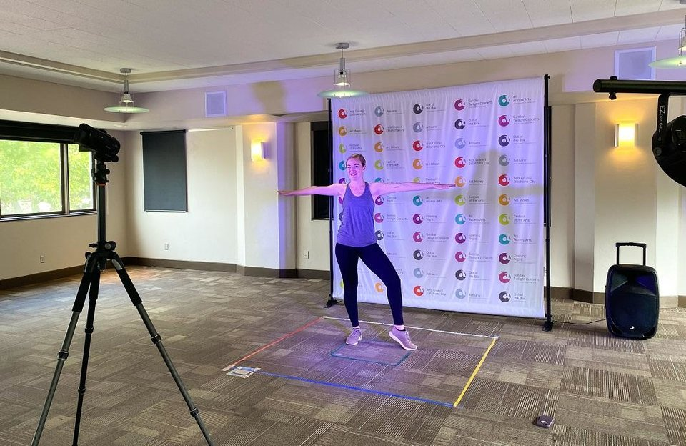 Photo - Dance Teaching Artist Samantha Russel films an art class at the Arts Council Oklahoma City offices. [Photo provided]