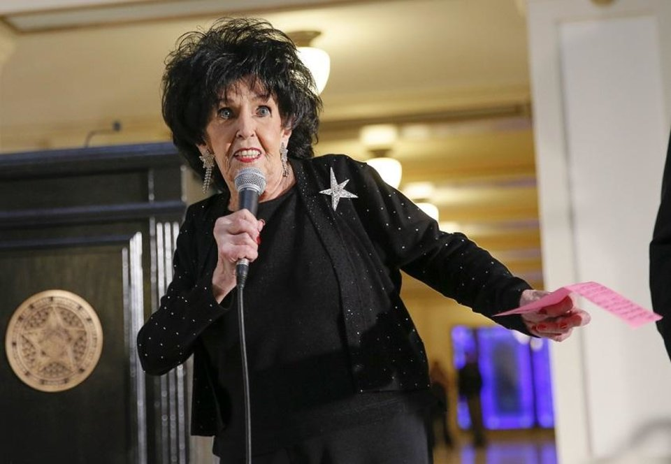 Photo - Wanda Jackson, recipient of the Oklahoma Cultural Treasure Award, does a quick dance move while speaking during the Governor's Arts Awards at the state Capitol in Oklahoma City, Wednesday, Feb. 28, 2018. Photo by Nate Billings, The Oklahoman Archives