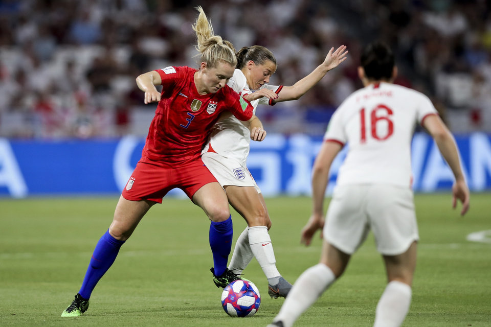 Photo - United States' Samantha Mewis, left, duels for the ball against England's Fran Kirby during the Women's World Cup semifinal soccer match between England and the United States, at the Stade de Lyon outside Lyon, France, Tuesday, July 2, 2019. (AP Photo/Francisco Seco)