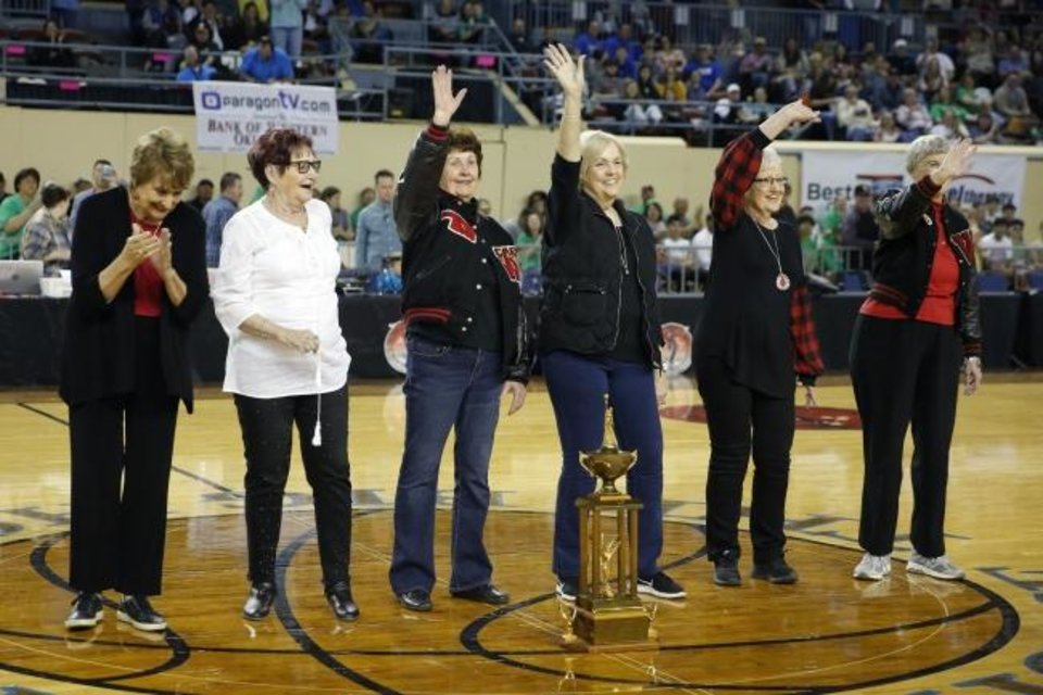 Photo -  Players from Wakita's 1960 Class B state championship team — from left, Kyle Dahlem, Joy Gideon, Sherrill Burlie, Donna Inman, Carol Ann Bolser and Dolores Gilliland — wave to the crowd while being honored at halftime of the 2020 Class B state championship game Saturday. [Bryan Terry/The Oklahoman]