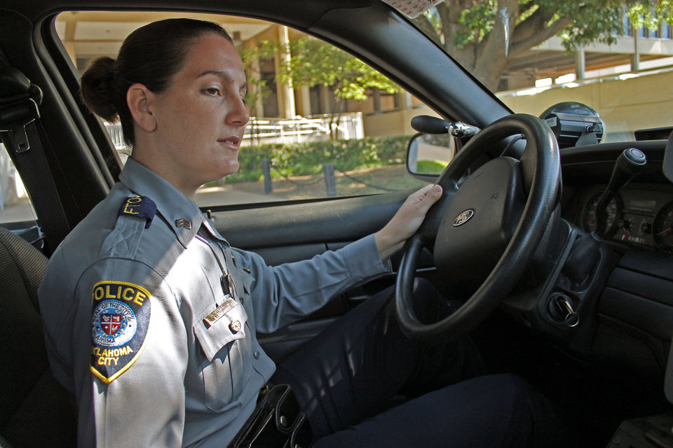 Photo - Sgt. Jennifer Morris, with the Oklahoma City police department, wanted to be a police officer as a girl. Photo by TIFFANY GIBSON, THE OKLAHOMAN