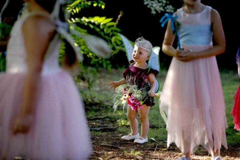 Photo -  Luna Creswell, 19 months, watches children chase bubbles during the 2019 Fairy Ball presented by Theatre Upon a StarDanceSwan at the Crown Jewel Amphitheater at First Christian Church in Oklahoma City on Saturday.
