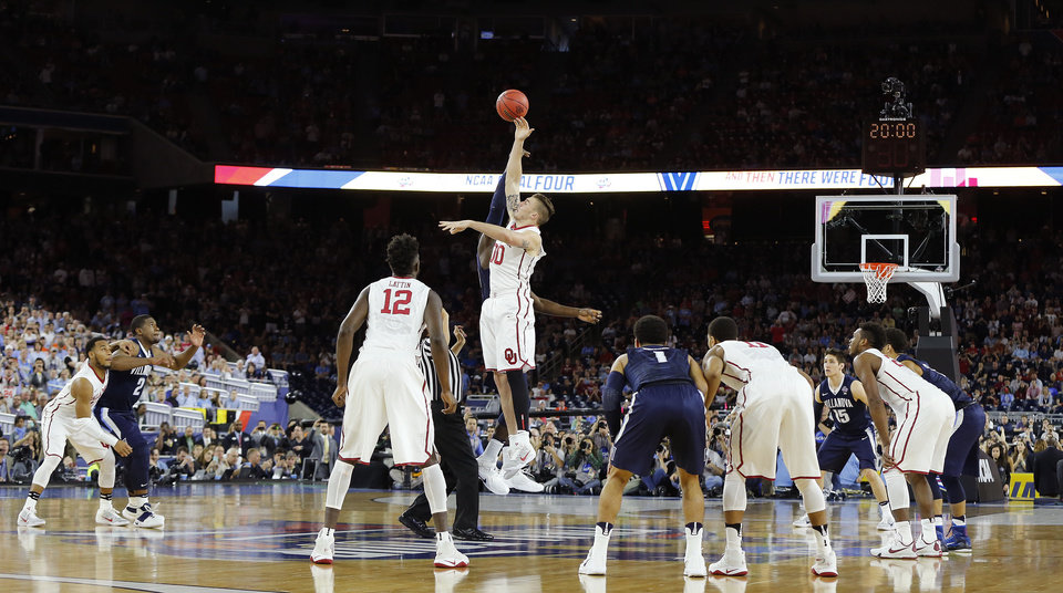 Photo - Oklahoma's Ryan Spangler (00) leaps for the ball during the opening tip of the national semifinal between the Oklahoma Sooners (OU) and the Villanova Wildcats in the Final Four of the NCAA Men's Basketball Championship at NRG Stadium in Houston, Saturday, April 2, 2016. Photo by Nate Billings, The Oklahoman
