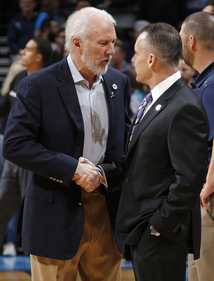 Photo - San Antonio coach Gregg Popovich and Oklahoma City coach Billy Dovonan meet before an NBA basketball game between the Oklahoma City Thunder and the San Antonio Spurs at Chesapeake Energy Arena in Oklahoma City, Saturday, March 26, 2016. Oklahoma City won 11-92. Photo by Bryan Terry, The Oklahoman