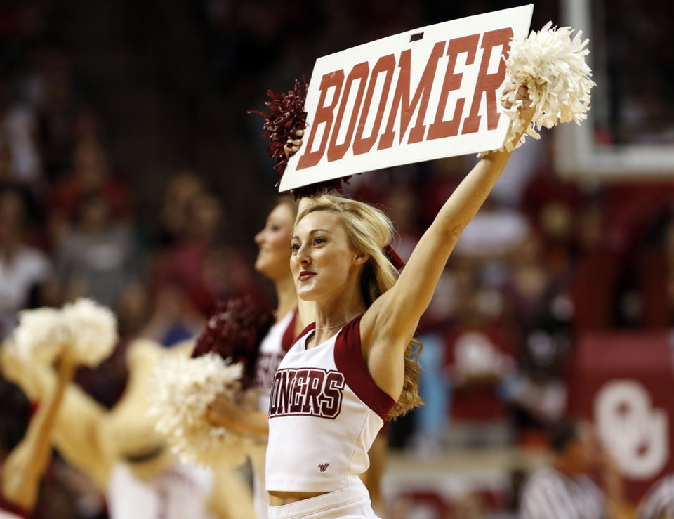 Photo - Cheerleaders involve the crowd as the University of Oklahoma Sooner (OU) men defeat the West Virginia Mountaineers (WV) 70-68 in NCAA, college basketball at The Lloyd Noble Center on Jan. 16, 2016 in Norman, Okla. Photo by Steve Sisney, The Oklahoman