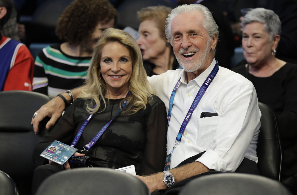Photo - President of the Miami Heat Pat Riley sits with his wife Chris Rodstrom Riley ahead of the first half of an NBA All-Star basketball game, Sunday, Feb. 17, 2019, in Charlotte, N.C. (AP Photo/Chuck Burton)