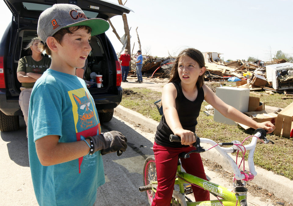 Photo - McClain Rogers and friend Emilee Rogers (no relation) talk about their good friend Sydney Angle in front of her home in the tornado devastated part of Moore, OK, Thursday, May 23, 2013. Sydney was killed by the tornado.  Photo by Paul Hellstern, The Oklahoman