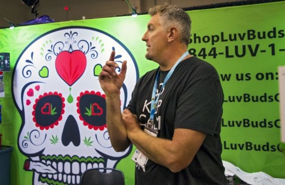 Photo -  Shawn Hermanson, of LuvBuds, speaks Friday about the products supplied by his company during the CannaCon convention. [CHRIS LANDSBERGER/THE OKLAHOMAN]