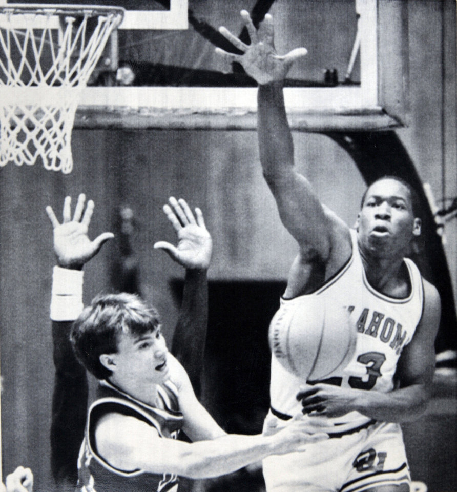 Photo - Former OU basketball player Wayman Tisdale. OU's Wayman Tisdale knocks down a shot by Damon Goodwin of Dayton in Saturday's NCAA Tournament play. Despite Tisdale's 36 points, the Sooners were ousted from the tourney by Dayton, 89-85. Photo taken unknown, published 3/18/1984 in The Daily Oklahoman. ORG XMIT: KOD