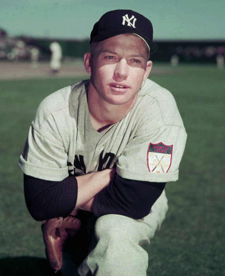 Photo - A youthful Mickey Mantle poses during spring training in 1951 at the age of 19. The future slugger and major league baseball icon began his long Yankee career April 17, 1951. Mantle's mammoth swing and country-boy charm made him a larger-than-life hero to generations of fans. The uniform patch on his left shoulder marks the American League's 50th anniversary. (AP Photo)
