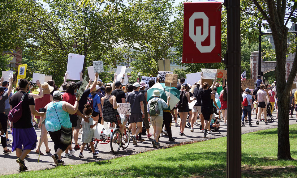 Photo - Protestors march down University Boulevard during the George Floyd protest on Saturday, June 6, 2020, in Norman, Okla. [Ellie Melero/The Oklahoman]