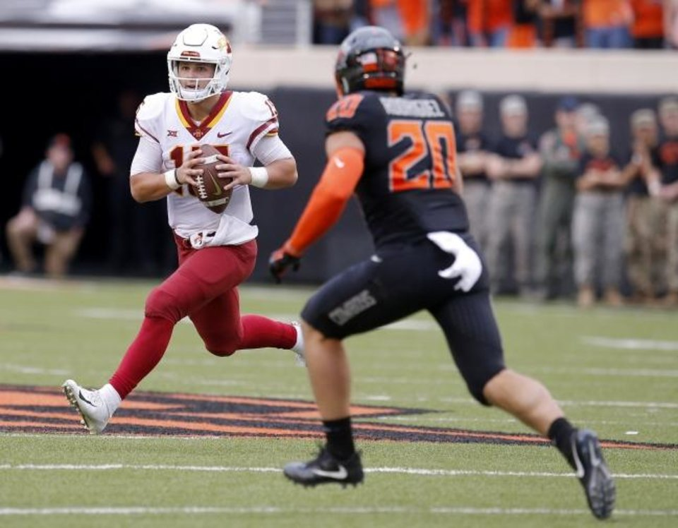 Photo -  Iowa State's Brock Purdy (15) looks to throw a pass as he is defended by Oklahoma State's Malcolm Rodriguez (20) in October of 2018 at Boone Pickens Stadium in Stillwater. [SARAH PHIPPS/THE OKLAHOMAN]