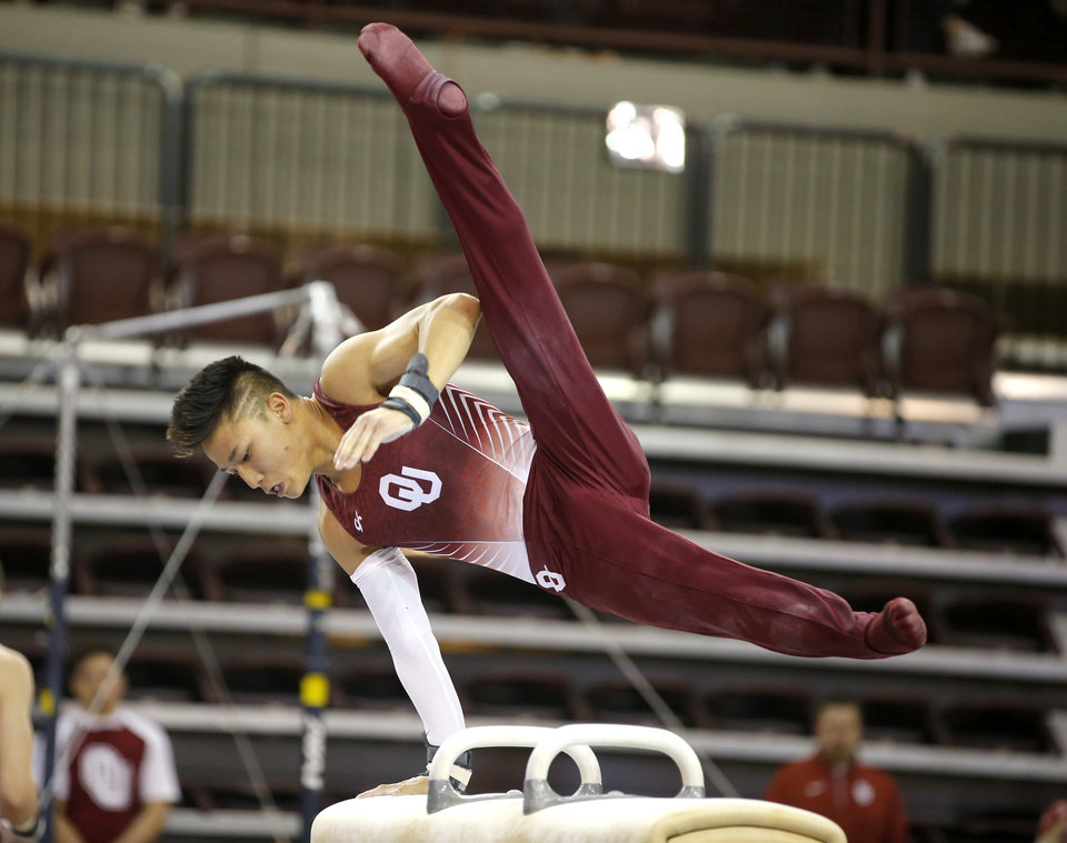 Photo - Oklahoma's Yul Moldauer competes on the pommel horse during a gymnastics meet with Illinois at McCasland Field House in Norman, Okla., Saturday, March 18, 2017. Photo by Bryan Terry, The Oklahoman