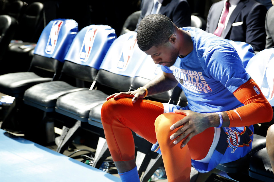Photo - Oklahoma City's Paul George (13) waits to be introduced before the NBA game between the Oklahoma City Thunder and the Utah Jazz at the Chesapeake Energy Arena, Friday, Feb. 22, 2019. Photo by Sarah Phipps, The Oklahoman