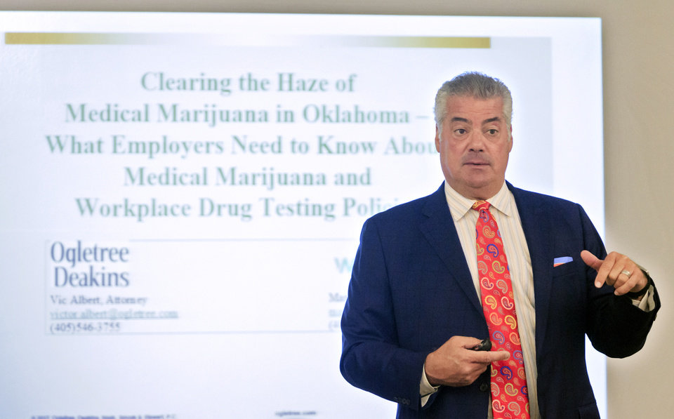 Photo -  Attorney Vic Albert explains a PowerPoint slide during a seminar for businesses as they adjust their policies to adapt to the passing of medical marijuana. [Photos by Chris Landsberger, The Oklahoman]