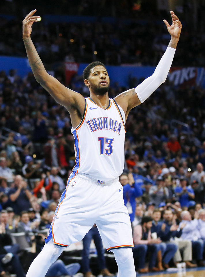 Photo - Oklahoma City's Paul George (13) celebrates during an NBA basketball game between the Utah Jazz and the Oklahoma City Thunder at Chesapeake Energy Arena in Oklahoma City, Monday, Dec. 10, 2018. Oklahoma City won 122-113. Photo by Nate Billings, The Oklahoman
