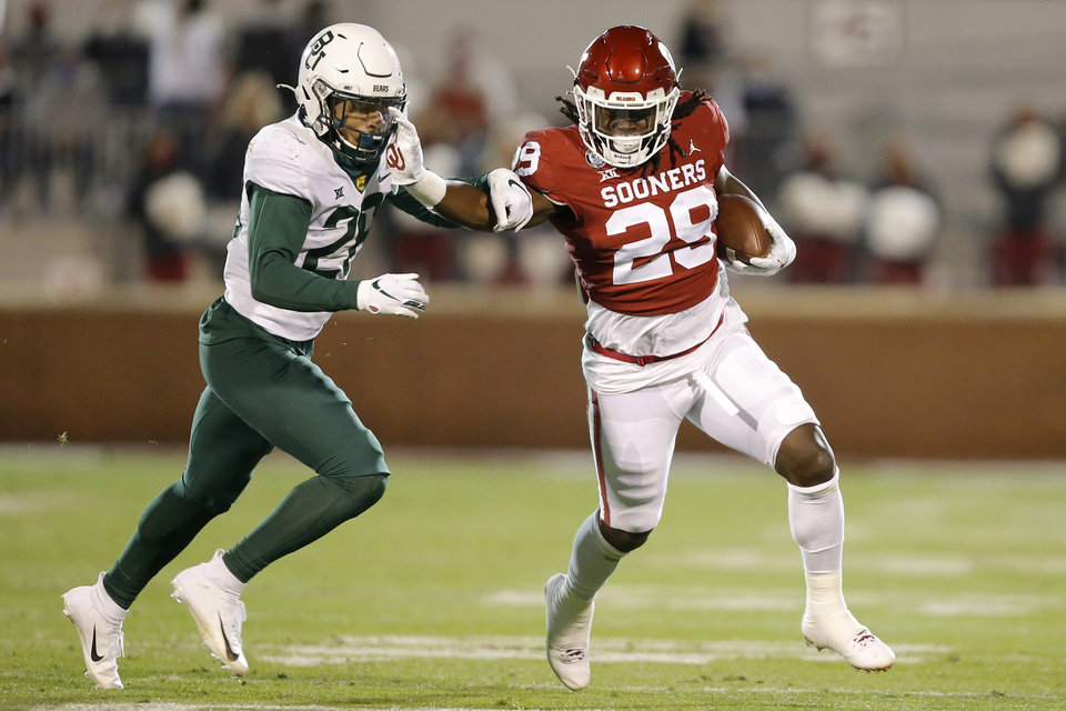 Photo - Oklahoma's Rhamondre Stevenson (29) fights off Baylor's Abram Smith (28) during college football game between the University of Oklahoma Sooners (OU) and the Baylor Bears at Gaylord Family-Oklahoma Memorial Stadium in Norman, Okla., Saturday, Dec. 5, 2020. [Bryan Terry/The Oklahoman]