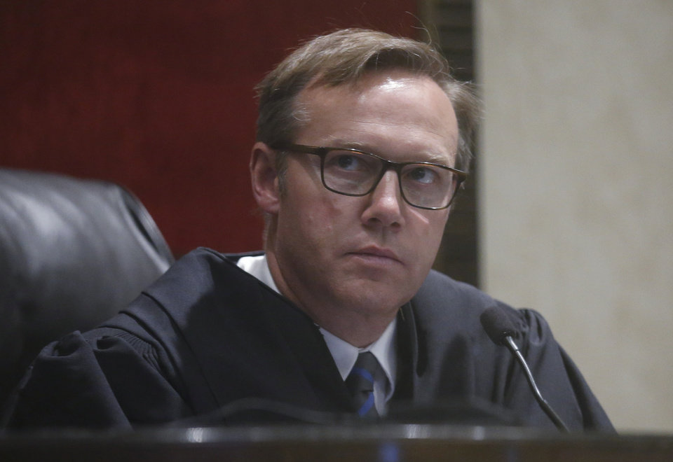 Photo - Judge Thad Balkman watches a video deposition Wednesday, May 29, 2019, in Norman, Okla., during Oklahoma's trial against drugmakers blamed for contributing to the opioid crisis. (AP Photo/Sue Ogrocki)