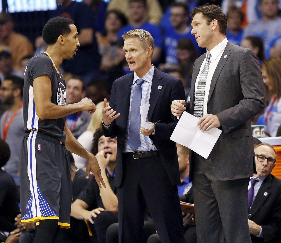 Photo - Golden State's Shaun Livingston (34) talks to head coach Steve Kerr, middle, and assistant coach Luke Walton during an NBA basketball game between the Oklahoma City Thunder and the Golden State Warriors at Chesapeake Energy Arena in Oklahoma City, Saturday, Feb. 27, 2016. Golden State won 121-118 in overtime. Photo by Nate Billings, The Oklahoman