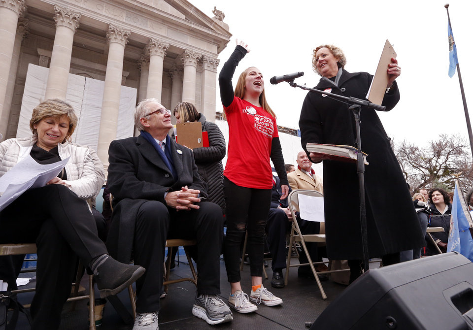 Photo - Hope Davis, Moore High School sophomore, speaks as Oklahoma teachers hold a rally at the State Capitol on Monday, April 2, 2018 in Oklahoma City, Okla.  Photo by Steve Sisney, The Oklahoman