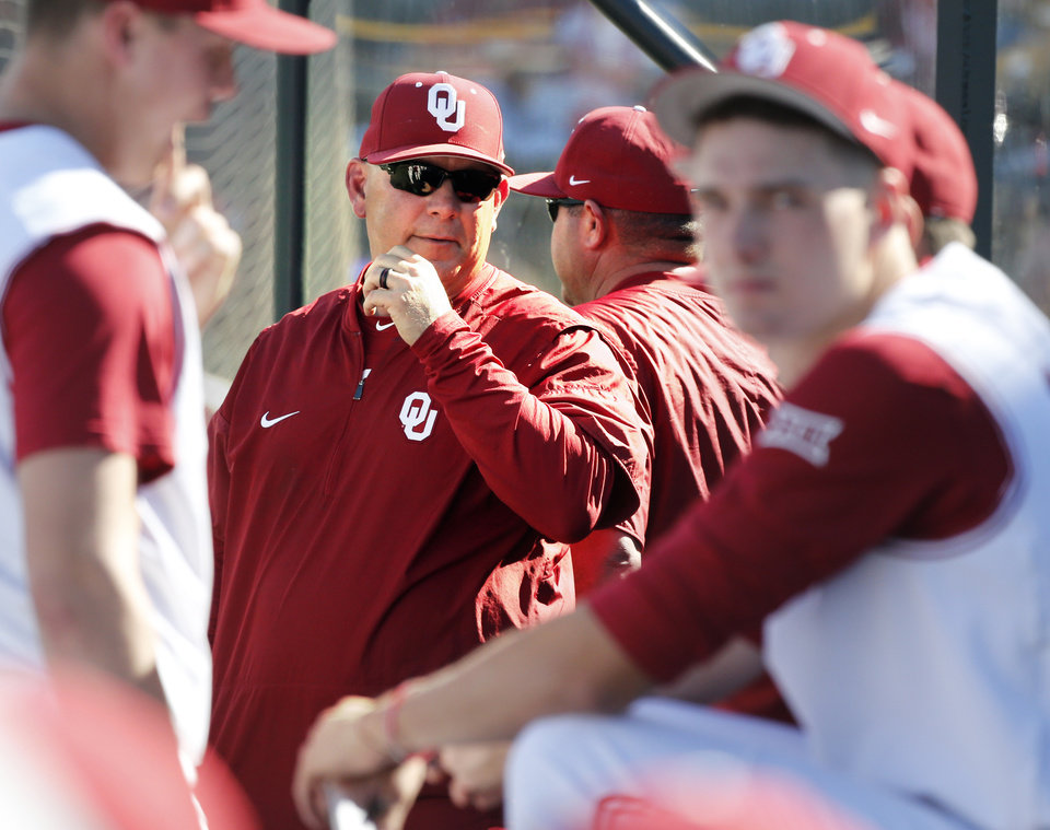 Head coach Skip Johnson stands in tshe dugout as the University of Oklahoma  Sooner (OU d9d5ac208