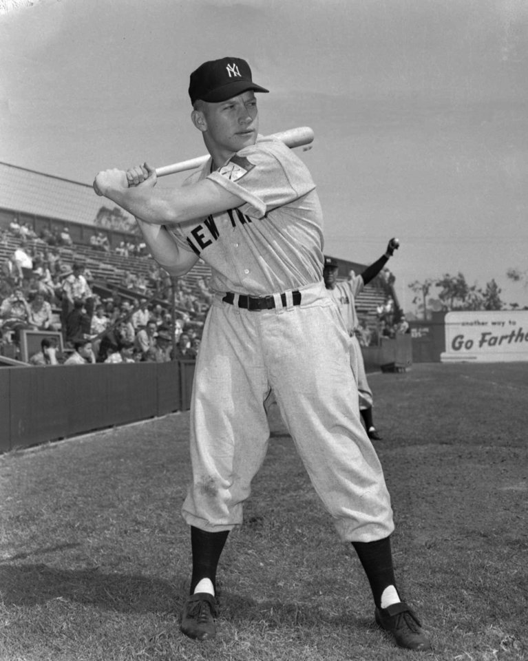 Photo - New York Yankees baseball player Mickey Mantle, at age 19, swings a bat in this March 21, 1951 file photo. (AP Photo/File)