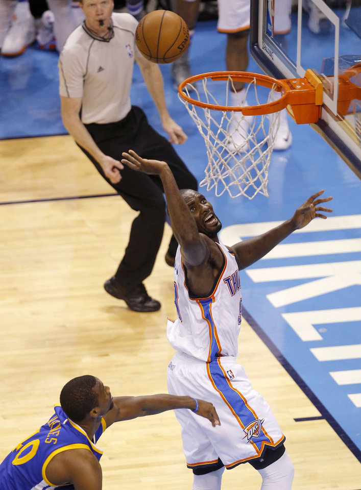 Photo - Oklahoma City's Serge Ibaka (9) puts up a shot beside Golden State's Harrison Barnes (40) during Game 6 of the Western Conference finals in the NBA playoffs between the Oklahoma City Thunder and the Golden State Warriors at Chesapeake Energy Arena in Oklahoma City, Saturday, May 28, 2016. Photo by Bryan Terry, The Oklahoman