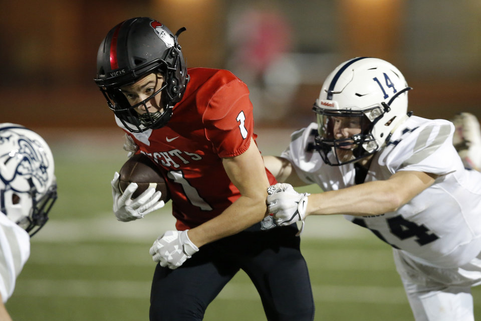 Photo - Mason Snyder of Crossings Christian gets past Minco's Corbin Burchfield during a high school football game between Crossings Christian and Minco in Oklahoma City, Friday, Sept. 13, 2019. [Bryan Terry/The Oklahoman]