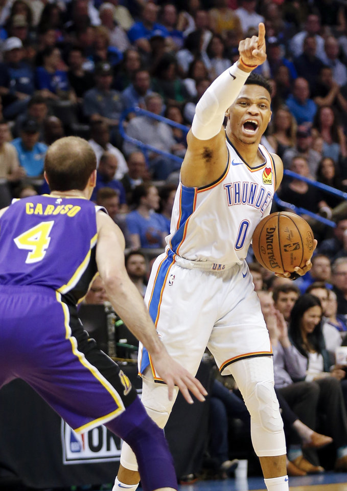 Photo - Oklahoma City's Russell Westbrook (0) directs his teammates near Los Angeles' Alex Caruso (4) in the second quarter during an NBA basketball game between the Los Angeles Lakers and the Oklahoma City Thunder at Chesapeake Energy Arena in Oklahoma City, Tuesday, April 2, 2019. Photo by Nate Billings, The Oklahoman