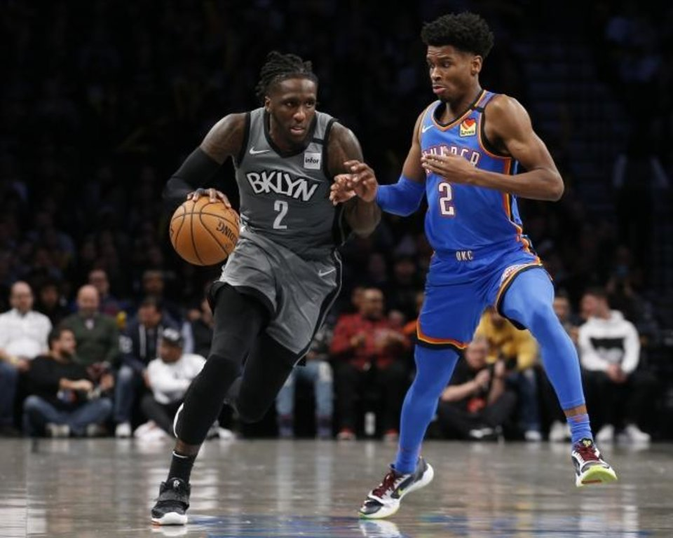 Photo -  Shai Gilgeous-Alexander defends Nets forward Taurean Prince. The Thunder will close its five-game road trip on Sunday night at Brooklyn. (Nicole Sweet-USA TODAY Sports)