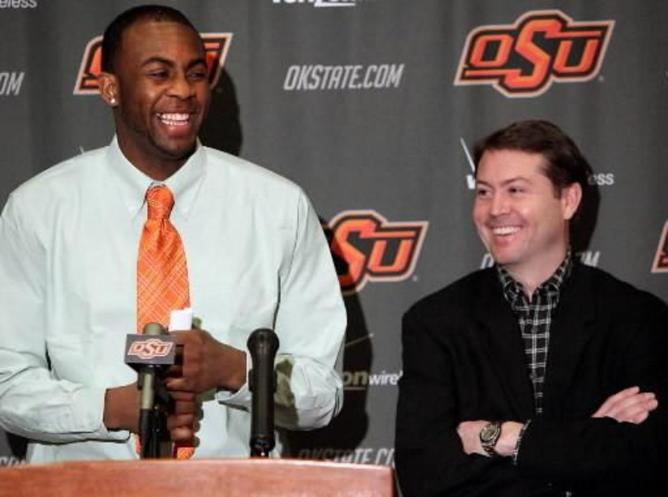 Photo - Oklahoma State basketball player James Anderson and Head Coach Travis Ford reacts to a joke by Travis Ford during a question at a press conference at Gallagher-Iba Arena on the OSU campus in Stillwater, Okla., on Monday, March 22, 2010. Anderson announced that he will enter the next NBA draft. Photo by  John   Clanton, The Oklahoman