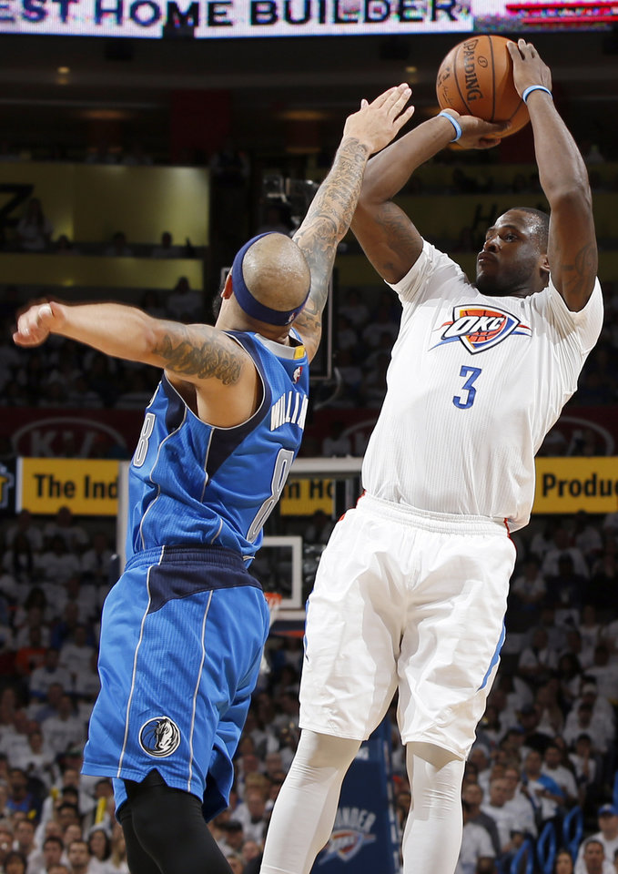 Photo - Oklahoma City's Dion Waiters (3) shoots against Dallas' Deron Williams (8) during Game 2 of the first round series between the Oklahoma City Thunder and the Dallas Mavericks in the NBA playoffs at Chesapeake Energy Arena in Oklahoma City, Monday, April 18, 2016. Photo by Nate Billings, The Oklahoman